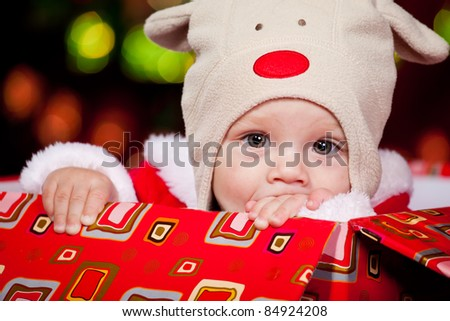 Christmas baby in a red present box - stock photo
