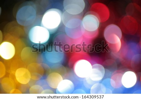 Christmas backdrop. Holiday background of defocused spot of light - stock photo