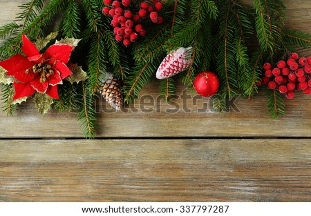 christmas backdrop with green branch and red decorations, top view - stock photo