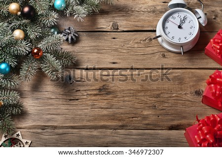 Christmas background. Christmas tree with Christmas decorations and Christmas present on a wooden background. Top view. Copy space. Free space for text - stock photo