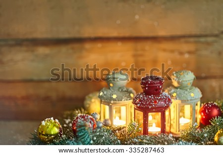 Christmas background composition with lanterns, baubles and fir in snow - stock photo
