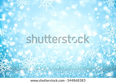 Christmas Background. Golden Holiday glowing Abstract Glitter Defocused Background With Blinking Stars and snowflakes. Blurred Blue color Bokeh  - stock photo