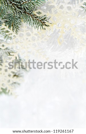 Christmas background made of spruce branch and snowflakes - stock photo
