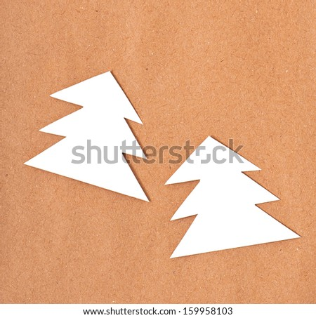 Christmas Background of old paper decorated with Christmas trees - stock photo