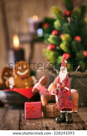 Christmas background. Santa Claus with Christmas tree,presents and gingerbread man. - stock photo