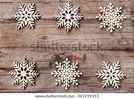 Christmas background: snowflakes on rustic wood - stock photo