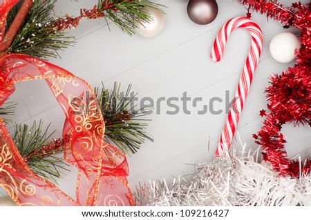 Christmas background wallpaper with candy cane and red festoons - stock photo