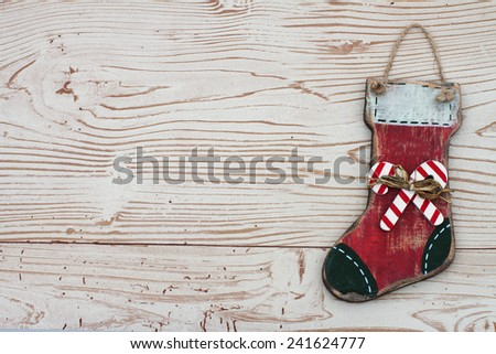 Christmas Background with a Stocking on Grunge Textured Wood Background  with copy space - stock photo
