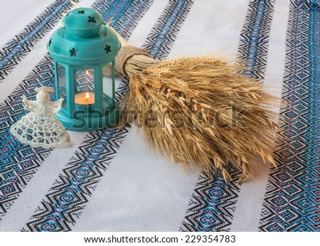 Christmas background with angel lantern and Didukh (diduch), traditional a home decoration in Ukraine - stock photo
