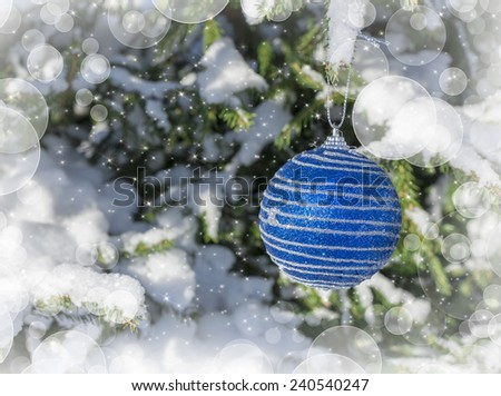 Christmas background with blue ball on the christmas tree in winter under snow - stock photo