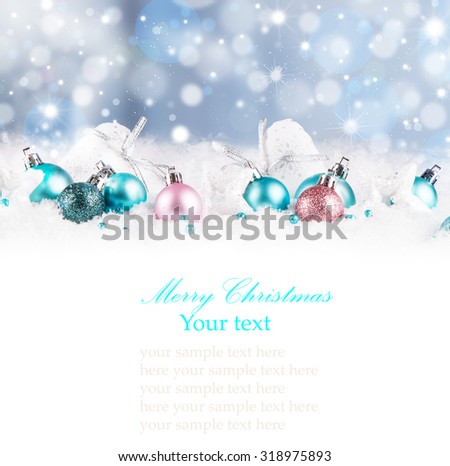 Christmas background with blue baubles,snow and snowflakes, free space for text. Christmas decoration.  - stock photo