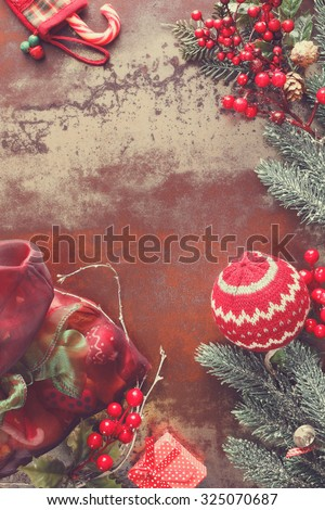 Christmas background with Christmas decorations and Santa sack with presents.  Vintage style with blank space - stock photo
