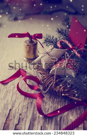 christmas background  with christmas decorations on wooden background in vintage color - stock photo