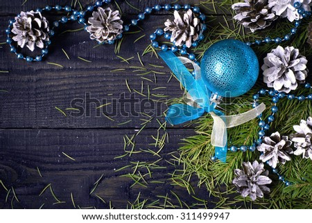 Christmas background with Christmas decorations, pine cones and spruce branch - stock photo