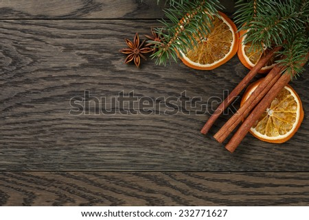christmas background with cinnamon anise and oranges, oak table - stock photo