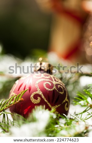 Christmas background with colourful shiny red and gold Xmas baubles with handcrafted straw ornaments and decorations tied with red ribbon for seasonal wishes - stock photo