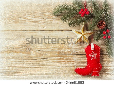 christmas background with cowboy shoe decoration toys.Wood texture for text - stock photo