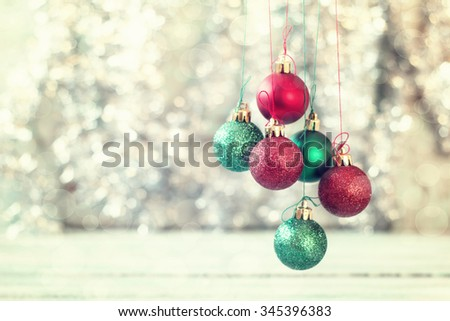 Christmas background with decorations on wooden board. Soft focus.Vintage filter - stock photo