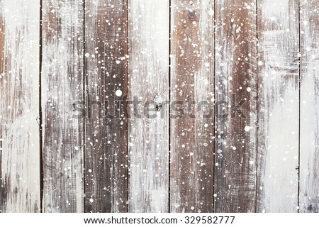Christmas background with falling snow over wooden background - stock photo