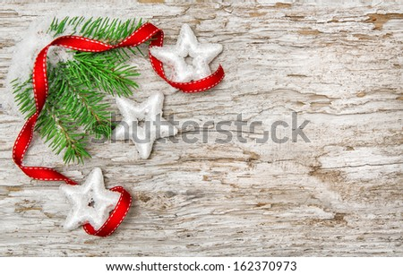 Christmas background with fir branch and red ribbon  - stock photo