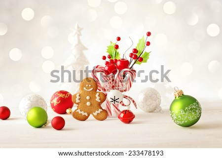 christmas background with gingerbread man cookie and christmas ornaments - stock photo