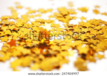 Christmas background with golden stars close-up - stock photo