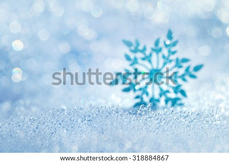 Christmas background with icy blurred decorative snowflake - stock photo