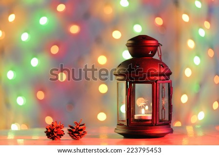 Christmas background with lantern and colorful lights - stock photo
