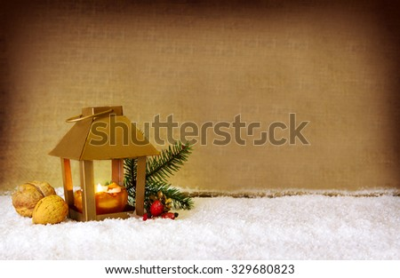 Christmas background with lantern .Golden lantern with candlelights for Christmas decoration.White snow. - stock photo