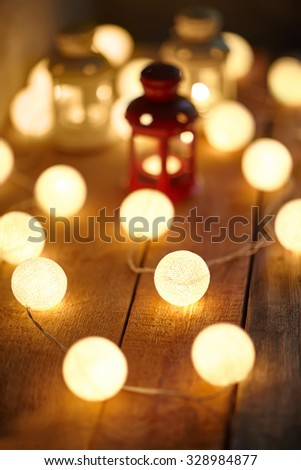 Christmas background with lanterns and garland. Holiday concept - stock photo