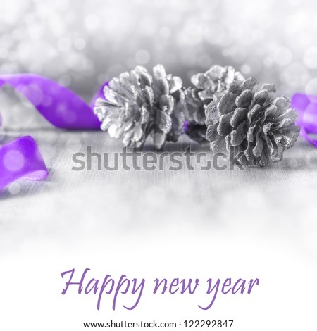 Christmas background with pine cones and a ribbon - stock photo