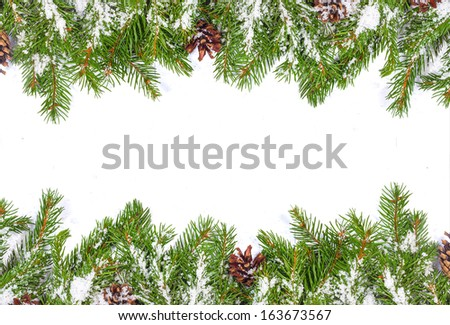 Christmas background with snow, and cones isolated on white - stock photo