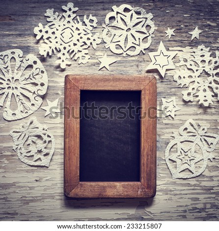 Christmas background with snowflakes and framed blackboard  - stock photo