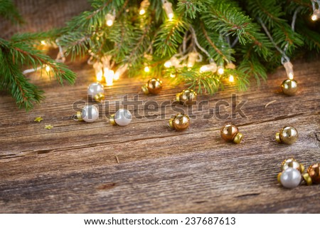 christmas background  - wooden table with defocused lights and glass decorationd - stock photo