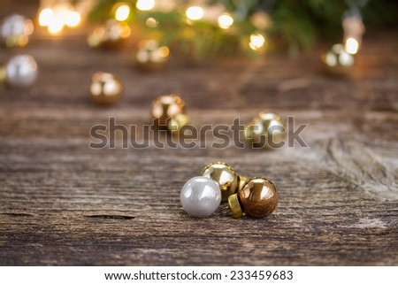 christmas background  - wooden table with glass balls and  defocused lights and decorationd - stock photo