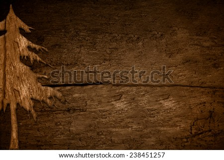 Christmas backgrounds,old blank  panel to write or post photos with a silhouette of fir wood - stock photo