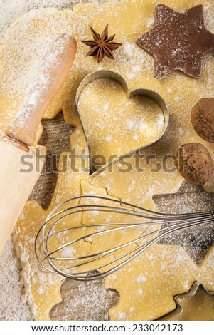 Christmas baking, cookies, rolling pin, anise, walnuts, - stock photo