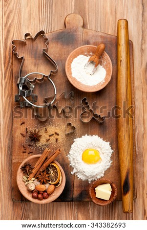 Christmas baking ingredients. Flour, eggs, butter and spices - stock photo