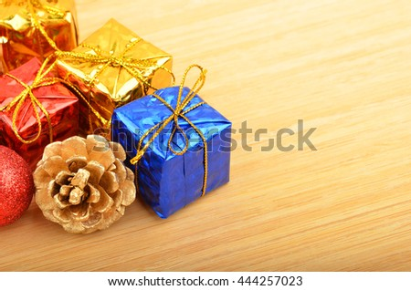Christmas ball and decoration on wooden background - stock photo
