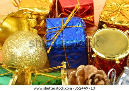 Christmas ball and decoration on wooden background, DOF - stock photo