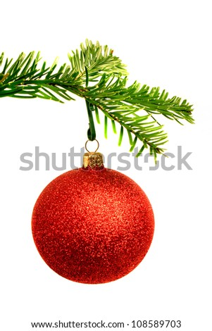 Christmas ball and fir branch over white background. - stock photo