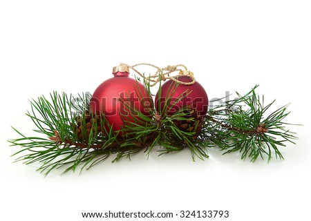 Christmas ball and green spruce branch - stock photo