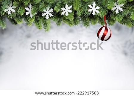 Christmas ball and snowflakes hanging on fir tree - stock photo