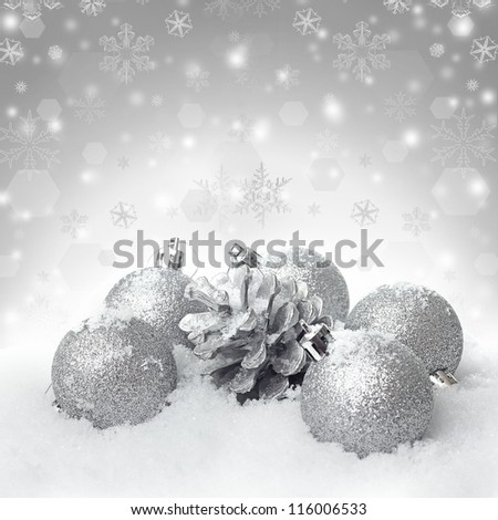 Christmas ball baubles with silver decoration on the snow - stock photo