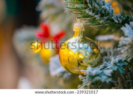 Christmas ball hanging on tree. - stock photo