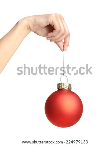 Christmas ball in hand isolated on white background - stock photo