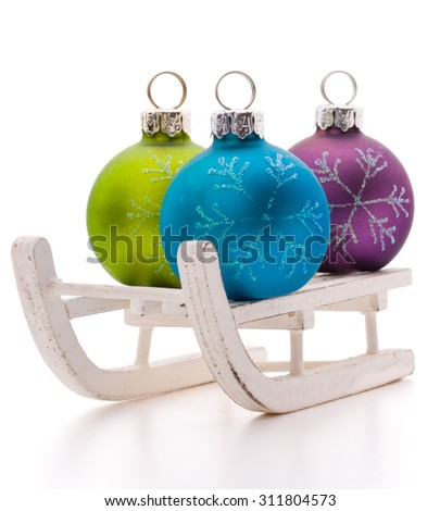 Christmas ball in sleds isolated on white background cutout. Christmas decoration. - stock photo