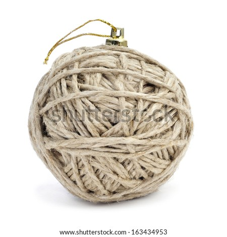 christmas ball made with a coil of hemp twine on a white background - stock photo