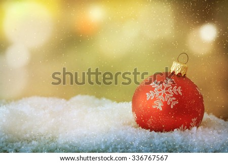 Christmas ball on snow - stock photo