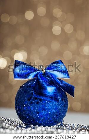 Christmas ball on sparkles background - stock photo